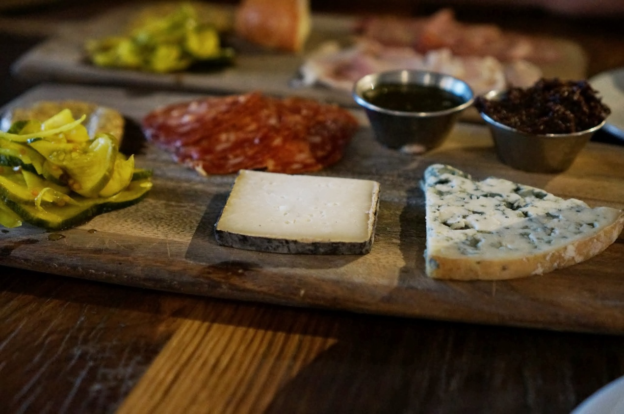Selection of salty pig parts and stinky cheeses