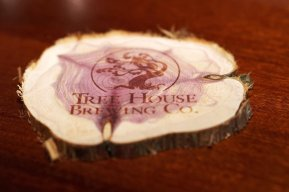 Laser-engraved Tree House logo coasters