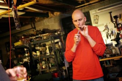 Ken lighting up a stogie, naturally
